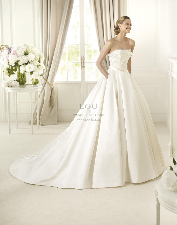 Свадебное платье бренда Pronovias, модель Dalamo - Красивое свадебное платье из шелкового атласа с карманами на пышной юбке. Вышивка жемчугом на корсете